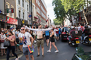 Football fans  blocking Charing Cross Rd.  after England won their game against Sweded,  2018, Soho, London. 7 July 2018