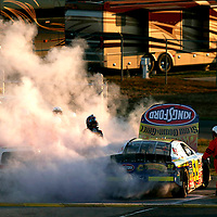 8-9 June, 2007, Nashville, Tennessee, USA.<br /> Marcos Ambrose looks for shrimps to toss on the barbie as his Kingsford Ford Fusion goes up in smoke.<br /> © 2007 Phillip Abbott/USA<br /> LAT Photographic