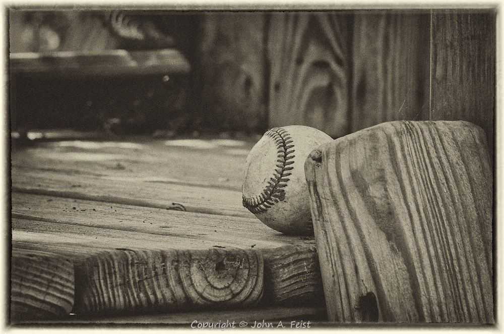 The baseball must have rolled around the playhouse until it bumped into the end of the ladder.