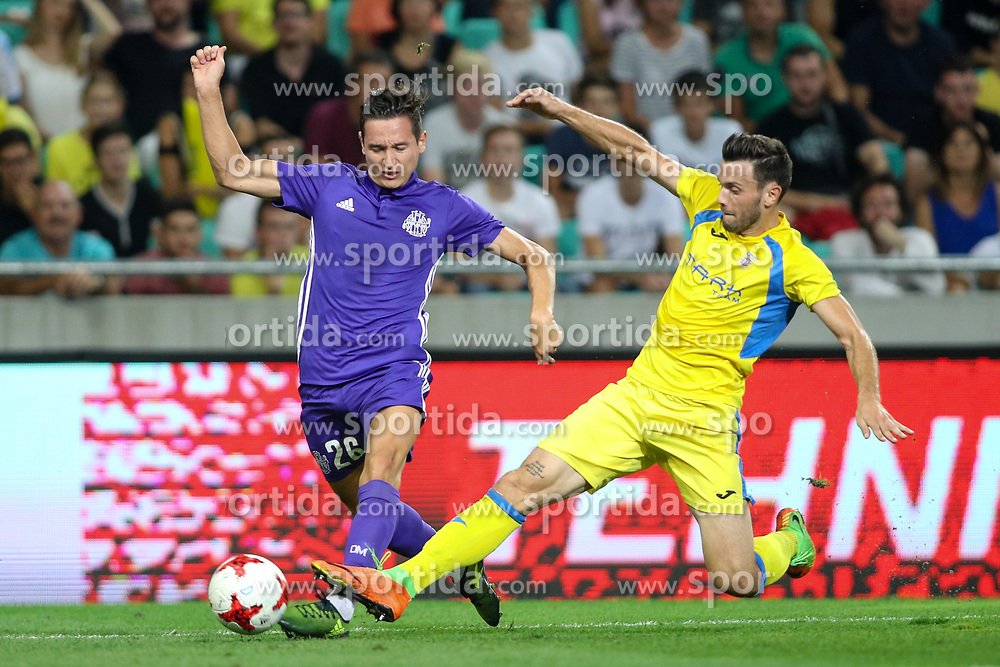 Florian Thauvin of Olympic Marseille and Amedej Vetrih of NK Domzale during football match between NK Domzale and Olympique de Marseille in First game of UEFA Europa League playoff round, on August 17, 2017 in SRC Stozice, Ljubljana, Slovenia. Photo by Morgan Kristan / Sportida