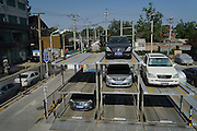 BEIJING, CHINA - (CHINA OUT) <br /> <br /> First Underground Multistorey Parking Garage<br /> <br /> Sedan cars park in a multi storey parking garage at Cheniandian Hutong  in Beijing, China. The first underground multi storey parking garage in Beijing Hutong appeared at Cheniandian Hutong of Dongcheng District in Beijing. Cheniandian Hutong, located between Guozijian Street and South Luogu Lane, just like many hutongs in Beijing has long been troubled by heavy traffic problems. With a capacity of nearly 200 parking spaces, the parking garage can help relieve the traffic pressure and improve public safety for the area. The administration will build more multi storey parking garages in Beijing Hutong.<br /> ©Exclusivepix