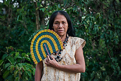 NO WEB/NO APPS - Exclusive. (Text available) Portrait of an Ese-Eja native woman wearing the traditional clothes of her native community 'Palma Real', near Puerto Maldonado, Peru on July 17, 2017. The Amazon rainforest is famous as 'The Lung of the Earth', but also for the presence of numerous native communities, who have always lived isolated and in close contact with nature for generations, used to seek for food and medicines and to build items directly from the environment in which they live. The unstoppable rise of globalization has drastically changed their needs, expectations and consequently their way of life. Located in the Tambopata National Reserve, on the border between Peru and Bolivia, the native Comunidad Palma Real is one of the clearest examples of this change. Living on the banks of the Madre de Dios River since approximately 1976, Palma Real comprises about 300 people part of the nomadic community Ese-Eja, established in the Amazon rainforest of Peru before the Spanish colonization. Photo by Giacomo d'Orlando/ABACAPRESS.COM