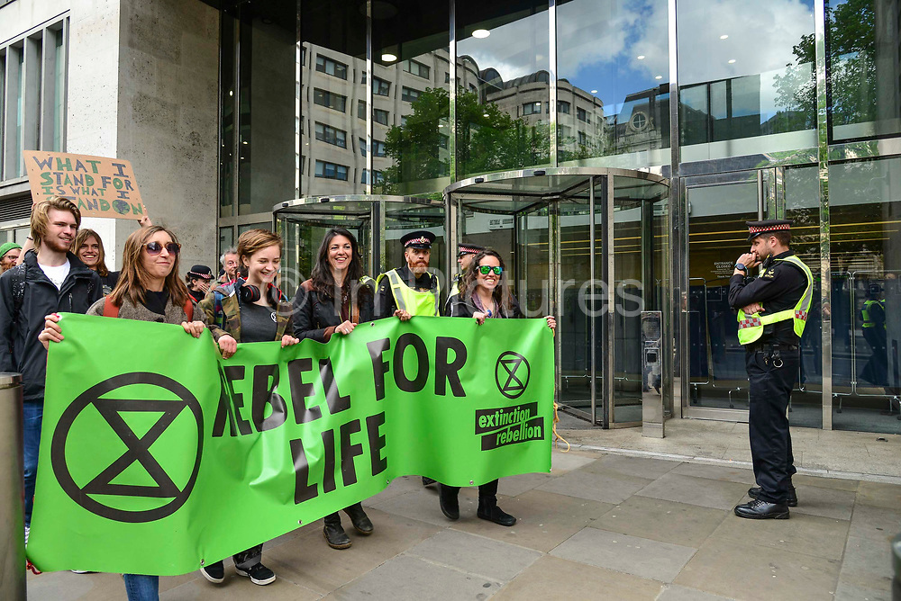 Climate change activists from the Extinction Rebellion group march and sing songs outside the London Stock Exchange demanding that the British Government acknowledge the climate crisis posed by global warming on 25th April 2019 in London, England, United Kingdom.