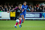 AFC Wimbledon defender Terell Thomas (6) battles for possession with Peterborough United attacker Sammie Szmodics (9) during the EFL Sky Bet League 1 match between AFC Wimbledon and Peterborough United at the Cherry Red Records Stadium, Kingston, England on 18 January 2020.