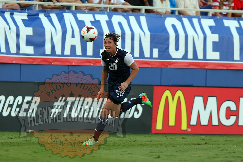U.S. forward Abby Wambach (20) chases the ball during an international friendly soccer match between the United States Women's National soccer team and the Russia National soccer team at FAU Stadium on Saturday, February 8, in Boca Raton, Florida. The U.S. won the match by a score of 7-0. (AP Photo/Alex Menendez)