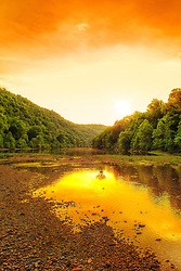 A Golden Sunset Along The Buffalo River, America's first national river, begins its 132-mile tumble down toward the White River in the upper Ponca wilderness, some of the most remote and rugged country in the Ozarks. This stretch of the river is not suitable for floating, has little access and is mostly seen only be dedicated hikers. But the river reaches the historic Boxley Valley and begins a peaceful meandering that stretches the length of the long, narrow break in the hills before it begins its magnificent sweeps around the high limestone bluffs for which it is famous.