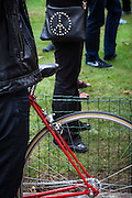 Red Bicycle and CND Peace Symbol at a Greenpeace Rally, Brussels, Belgium. The protestors, who met at Place de la Liberte, Brussels, were calling for the release of 30 activists being held in Murmansk, Russia, for protesting against oil drilling in the Arctic. 5 October 2013.