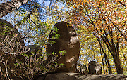Indian Rocks, fall foliage color in mid October. Walk 0.3 miles to the impressive boulders of Indian Rocks from Indian Gap Parking Area (Milepost 47.5, elevation 2098 feet) on Blue Ridge Parkway, in Virginia, in the Blue Ridge Mountains (a subset of the Appalachian Mountains), USA. The scenic 469-mile Blue Ridge Parkway was built 1935-1987 to aesthetically connect Shenandoah National Park (in Virginia) with Great Smoky Mountains National Park in North Carolina, following crestlines and the Appalachian Trail.  This panorama was stitched from 6 overlapping photos. (I digitally removed human graffiti from the rock.)