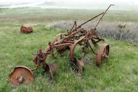 Rusted farming implement on Nantucket island, Massachusetts, USA