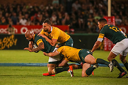 Lionel Mapoe of SA is tackled by Quade Cooper and Bernard Foley during the Castle Lager Rugby Championship test match between South Africa and Australia held at Loftus Versfeld stadium in Pretoria on the 1st October 2016<br /> <br /> Photo by: Dominic Barnardt/ RealTime Images