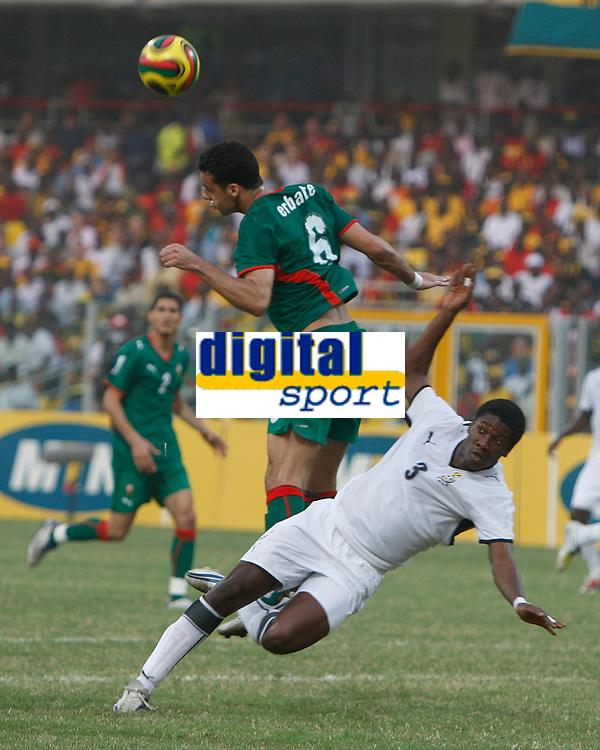 Photo: Steve Bond/Richard Lane Photography.<br /> Ghana v Morocco. Africa Cup of Nations. 28/01/2008. Elamin erbate (L) clears as Asamoah Gyan (R) goes over