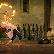 Hot street performance at the foot of the cathedral of Granada.