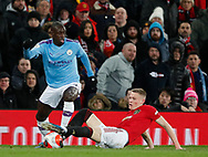 Scott McTominay of Manchester United tackles Benjamin Mendy of Manchester City during the Premier League match at Old Trafford, Manchester. Picture date: 8th March 2020. Picture credit should read: Darren Staples/Sportimage