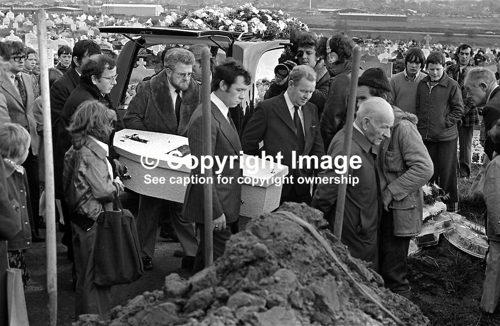 The little white coffin of Eileen Kelly, 6 years, arrives at the graveside in Milltown Cemetery. Her father is side on to the camera and wearing a pin-striped suit. Eileen died, 30th October 1975, in a Provisional IRA gun atttack targeting her father who was described as a Republican Clubs sympathiser. The Republican Clubs organization is the political wing of the Official IRA. The funeral was on 3rd November 1975. 197511030711b.<br /> <br /> Copyright Image from Victor Patterson, Belfast, UK<br /> <br /> t: +44 28 9066 1296 (from Rep of Ireland 048 9066 1296)<br /> m: +44 7802 353836<br /> e: victorpattersonbelfast@gmail.com<br /> <br /> www.images4media.com<br /> <br /> Please see my full Terms and Conditions of Use at https://www.images4media.com/p/terms-conditions - it is IMPORTANT that you familiarise yourself with them.<br /> <br /> Images used online incur an additional cost. This cost should be agreed in writing in advance. Online images must be visibly watermarked i.e. © Victor Patterson or that of the named photographer within the body of the image. The original metadata must not be deleted from images used online.<br /> <br /> This image is only available for the use of the download recipient i.e. television station, newspaper, magazine, book publisher, etc, and must not be passed on to a third party. It is also downloaded on condition that each and every usage is notified within 7 days to victorpattersonbelfast@gmail.com.<br /> <br /> The right of Victor Patterson (or the named photographer) to be identified as the author is asserted in accordance with The Copyright Designs And Patents Act (1988). All moral rights are asserted.