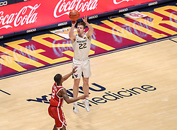 Feb 13, 2021; Morgantown, West Virginia, USA; West Virginia Mountaineers guard Sean McNeil (22) shoots a three pointer over Oklahoma Sooners guard Umoja Gibson (2) during the second half at WVU Coliseum. Mandatory Credit: Ben Queen-USA TODAY Sports