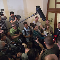 Tamas Gyarfas (C) vice-president of FINA swimming association and his lawyer Janos Banati (R) talk to the media after a court ruling connected to his arrest in a murder case in Budapest, Hungary on April 20, 2018. ATTILA VOLGYI