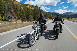 """Frankfurt, Germany Harley-Davidson dealer Thomas Trapp (L) riding his 1916 Harley-Davidson F beside Andreas """"Andy"""" Kaindl of Southern Germany on his 1924 Henderson Deluxe on Colorado Highway 91 to Leadville during Stage 10 (278 miles) of the Motorcycle Cannonball Cross-Country Endurance Run, which on this day ran from Golden to Grand Junction, CO., USA. Monday, September 15, 2014.  Photography ©2014 Michael Lichter."""