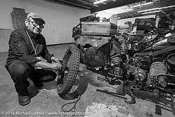 """Giuseppe Savoretti of Italy working on his 1931 Moto Guzzi on the Friday """"Rest Day"""" between stages 7 and 8 of the Motorcycle Cannonball Cross-Country Endurance Run in Junction City, KS., USA. Friday, September 12, 2014.  Photography ©2014 Michael Lichter."""