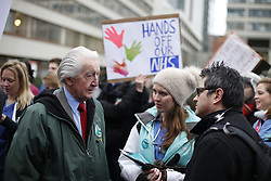 © Licensed to London News Pictures. 10/02/2016. London, UK. Veteran Labour MP Dennis Skinner (L) talks with junior doctors and supporters  on a picket line outside St Thomas' Hospital. Doctors are holding a one day strike over proposed new working hours - only the second strike in 40 years. Photo credit: Peter Macdiarmid/LNP