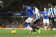 Romelu Lukaku of Everton shields the ball from Chancel Mbemba of Newcastle United. Barclays Premier League match, Everton v Newcastle United at Goodison Park in Liverpool on Wednesday 3rd February 2016.<br /> pic by Chris Stading, Andrew Orchard sports photography.