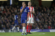 Pedro of Chelsea reacts rubs his chin in confusion. <br /> Premier league match, Chelsea v Stoke city at Stamford Bridge in London on Saturday 30th December 2017.<br /> pic by Kieran Clarke, Andrew Orchard sports photography.