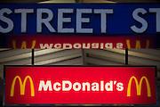 The sign for McDonalds under the Bond Street Tube station sign.