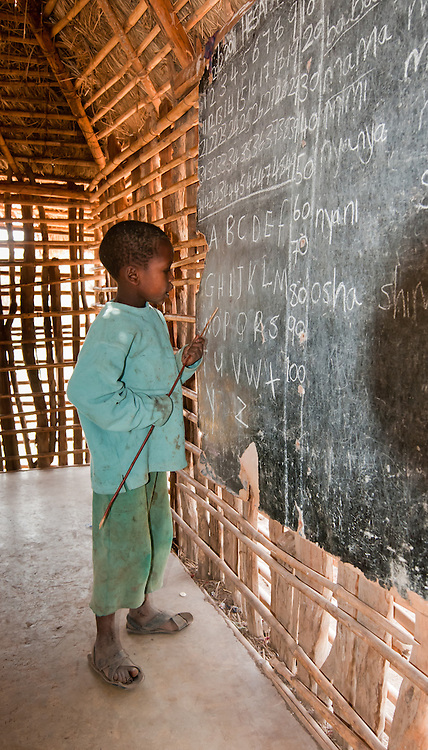 Inside Maasai school house with children
