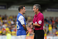 Sheffield Wednesday midfielder Ross Wallace (33) discusses a decision with referee Darren Bond during the EFL Sky Bet Championship match between Burton Albion and Sheffield Wednesday at the Pirelli Stadium, Burton upon Trent, England on 26 August 2017. Photo by Richard Holmes.