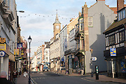 View of the main shopping street, High Street, Ilfracombe in winter evening light, north Devon, England