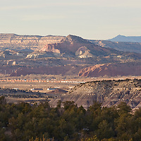121212     Brian Leddy<br /> A train rolls through the valley near Churchrock Tuesday afternoon. The many layers of landscape, including Pyramid Point, Fort Wingate, the Yellow Cliffs and the Chuska Mountains are visible from a vantage point on Highway 400 near Wingate.
