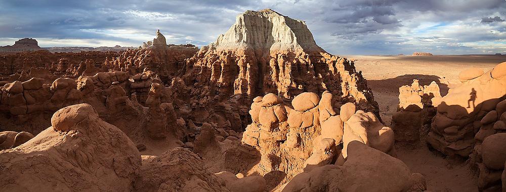 A vast field of hoodoos and high mesas at Goblin Valley State Park, Utah.
