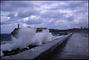 Waves crashing against Malecon Harbour, Havana, Cuba