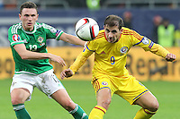 ROMANIA, Bucharest : Romania's Bogdan Stancu (R) and Northern Ireland's Corry Evans (R) vie for the ball during the Euro 2016 Group F qualifying football match Romania vs Northern Ireland in Bucharest, Romania on November 14, 2014.