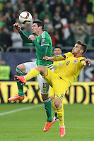ROMANIA, Bucharest : Romania's Mihai Pintilii (R) and Northern Ireland's Kyle Lafferty (L) vie for the ball during the Euro 2016 Group F qualifying football match Romania vs Northern Ireland in Bucharest, Romania on November 14, 2014.