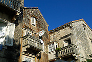 Old stone houses and balconies in Korcula old town, with satellite dish. Island of  Korcula, Croatia