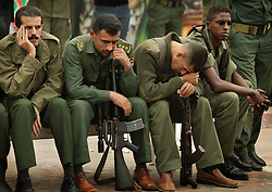Members of Yasser Arafat's personal security detail, Force 17, mourn the loss of their leader in front of his presidential offices, Gaza, Palestinian Territories, Nov. 11, 2004. Arafat died in a Paris hospital at the age of 75.