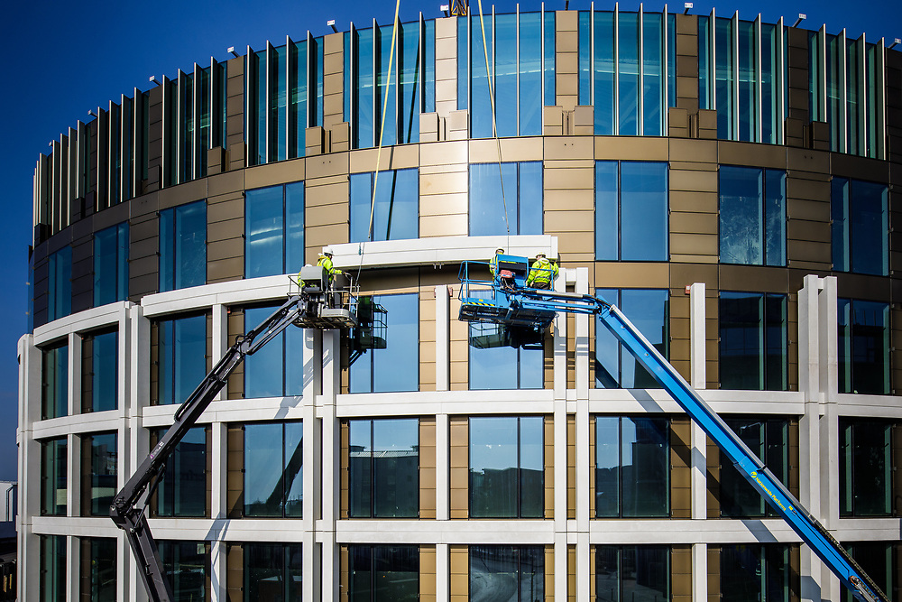 Men at work on the construction site of coporate offices in the offshore banking and finance area of St Helier, Jersey, CI