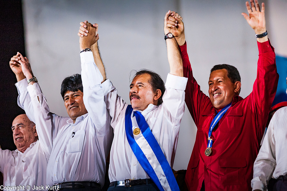 """10 JANUARY 2007 - MANAGUA, NICARAGUA: EVO MORALES, left, President of Bolivia, DANIEL ORTEGA, President of Nicaragua, and HUGO CHAVEZ, President of Venezuela, at Ortega's inauguration in Managua. Daniel Ortega, the leader of the Sandanista Front, was sworn in as the President of Nicaragua Wednesday. Ortega and the Sandanistas ruled Nicaragua from their victory of """"Tacho"""" Somoza in 1979 until their defeat by Violetta Chamorro in the 1990 election.  Photo by Jack Kurtz"""