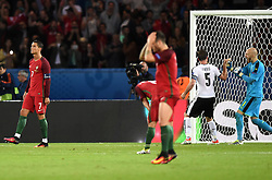 Cristiano Ronaldo of Portugal reacts to hitting the post with his penalty as Robert Almer of Austria celebrates  - Mandatory by-line: Joe Meredith/JMP - 18/06/2016 - FOOTBALL - Parc des Princes - Paris, France - Portugal v Austria - UEFA European Championship Group F
