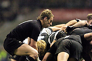 Twickenham, Surrey, 4th December 2004, The Gartmore Challenge Rugby Cup,  Barbarians vs New Zealand, RFU Stadium, England,<br /> All Black scrum half Jimmy Cowan feeds the ball into the scrum.<br /> [Mandatory Credit; Peter Spurrier/Intersport Images]