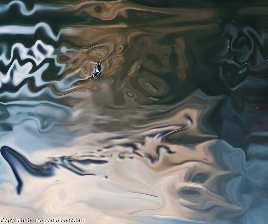abstract sunset reflections in pond water. On silky water surface fluid floating shapes and light evening colors in blue dominant.