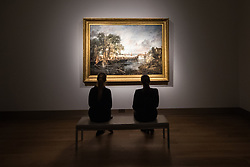"Christie's, St James, London. Two women admire the landscape as Christie's in London announce the sale of a work of genius by John Constable, the full scale six-foot ""sketch"" for ""View on the Stour near Dedham"" painted between 1821 and 1822, which is expected to fetch between £18-22 million at auction."