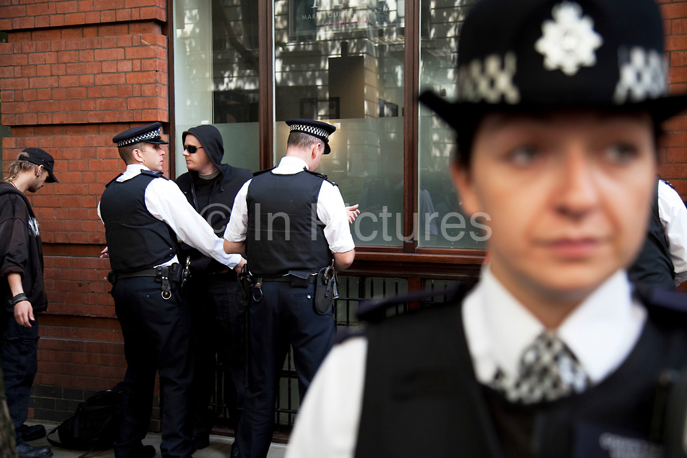Police using their powers of stop and search during the general strike march in central London. At this point the police were arresting / searching and detaining people they suspected were part of anarchist groups or members of Black Watch determined to create havoc in London on the day.