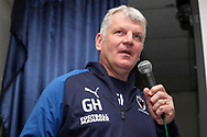 AFC Wimbledon manager Glyn Hodges talking into microphone during the EFL Sky Bet League 1 match between AFC Wimbledon and Doncaster Rovers at the Cherry Red Records Stadium, Kingston, England on 14 December 2019.