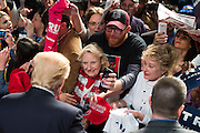 Donald Trump visits with supporters during a campaign rally on February 26, 2016 in Fort Worth, Texas.  (Cooper Neill for The New York Times)