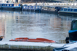© Licensed to London News Pictures. 03/02/2019. Bristol, UK. Winter weather. Ice on the water in Bristol docks by the boats moored along the quayside. Photo credit: Simon Chapman/LNP