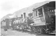"""These are the remains of a train wreck staged on July 17, 1951 for the Paramount Pictures movie """"Denver and Rio Grande"""" at MP 475, Tall Timber Resort.  The near engine is #319.  The engine at center appears to be #268 but is actually #345 as it was painted especially for the movie.  Both of these engines would be scrapped in September, 1951 as a result of this crash.   The engine at far left is #473 still in its Grande Gold paint from the D&RGW's Silverton Train promotions of 1950.<br /> D&RGW  Durango, CO  7/1951"""