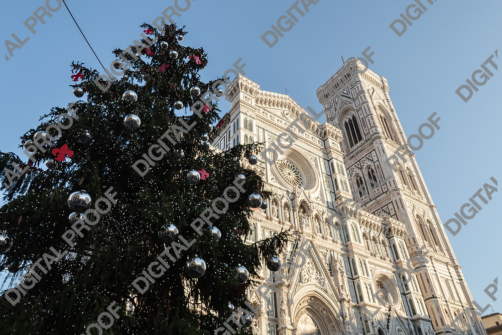 Firenze, Tuscany Italy - December 30, 2018 frontal lower view the Duomo of Florence Giotto's Bell Tower and FLorence Christmas Tree during the day
