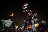 Anti government demonstrators in Tahrir Square celebrate late into the night after hearing news of Morsi's arrest by the military.