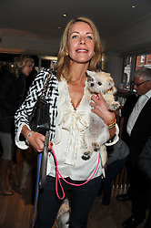ELENA MOJDEHI and her dog Mimi Mouse at the 10th anniversary of George in association with The Dog's Trust held at George, 87-88 Mount Street, Mayfair, London on 13th September 2011.
